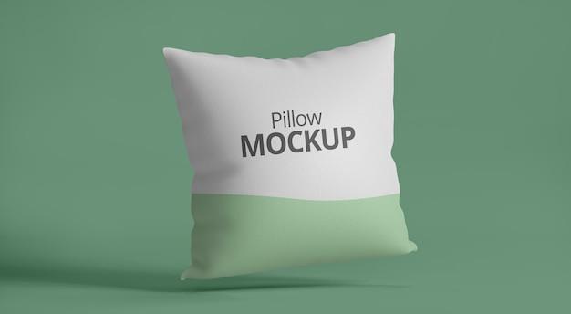 Maquete de travesseiro com fundo verde