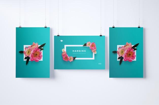 Maquete de três cartazes pendurados
