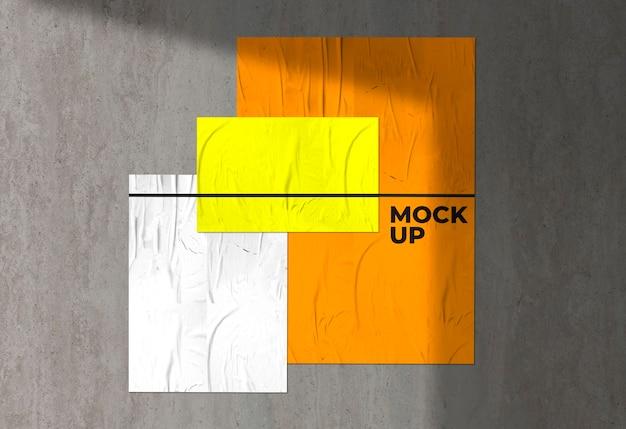 Maquete de três pôsteres coloridos amassados