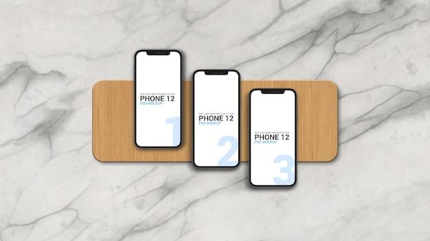 Maquete de três smartphones para apresentação de iu do aplicativo