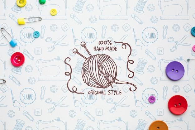 Maquete de tricô com alfinetes de segurança