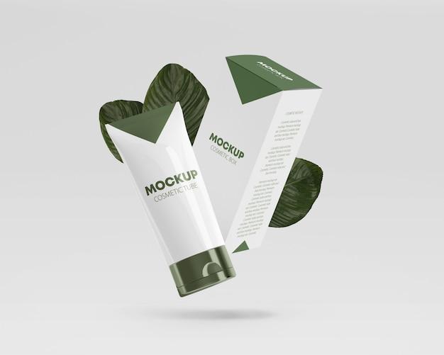 Maquete de tubo cosmético brilhante a voar com caixa e folhas