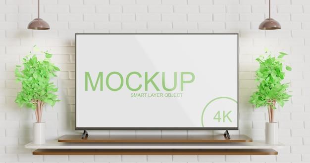 Maquete de tv moderna na mesa contra a parede de tijolos