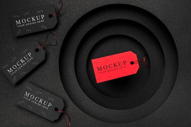 Maquete de vendas de etiquetas de preço em vermelho e preto na sexta-feira preta
