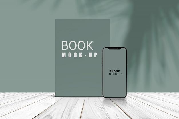 Maquete de visualização de suporte de telefone e livro