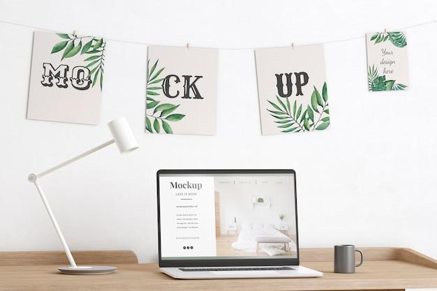 Maquete decorada de quarto de artista com laptop