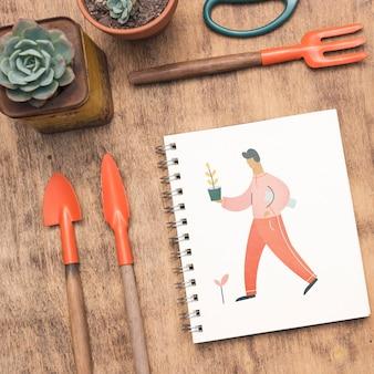 Maquete do bloco de notas com conceito de jardinagem