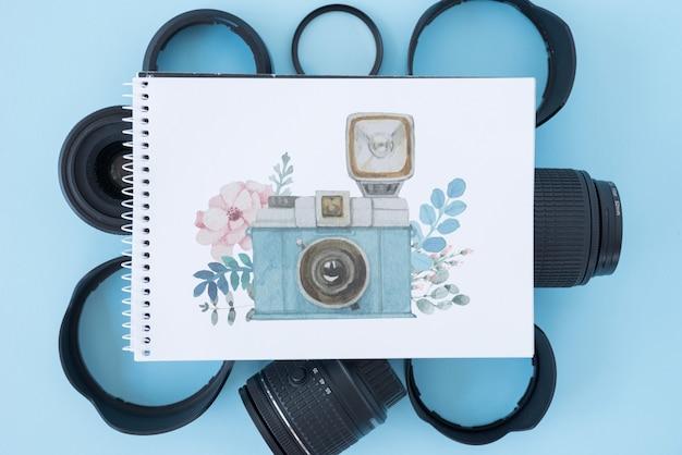 Maquete do bloco de notas com o conceito de fotografia