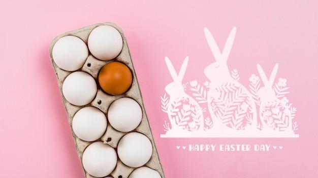 Maquete do dia de páscoa com ovos e coelhos