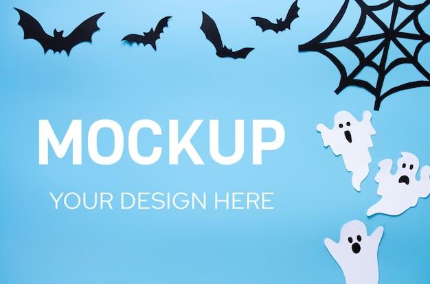 Maquete do feriado de halloween com papel artesanal na forma de fantasmas, teias de aranha e morcegos
