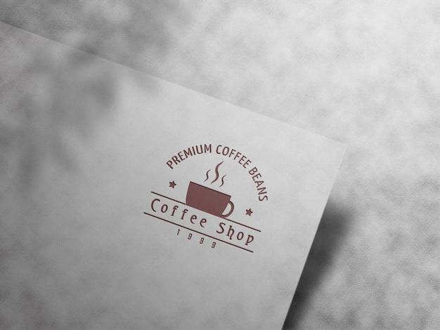 Maquete do logotipo com relevo e relevo no fundo de couro