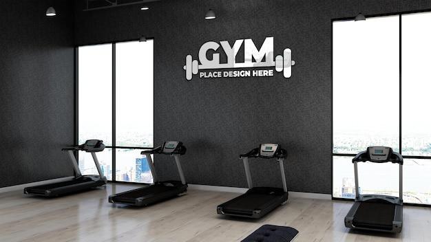 Maquete do logotipo da academia 3d na área de fitness com a parede preta para o atleta