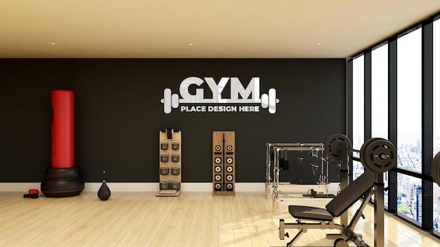 Maquete do logotipo da academia de parede na moderna sala de ginástica