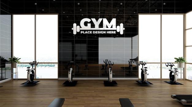 Maquete do logotipo da academia ou esportes na sala de ginástica com parede preta