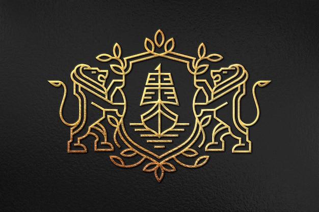 Maquete do logotipo da folha de ouro em superfície texturizada escura