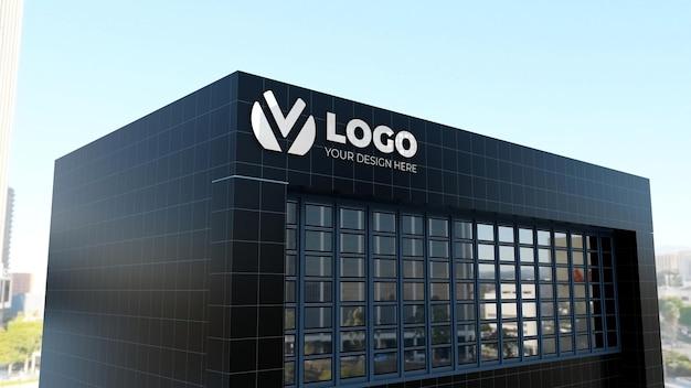 Maquete do logotipo do sinal 3d em um prédio de empresa de parede preta