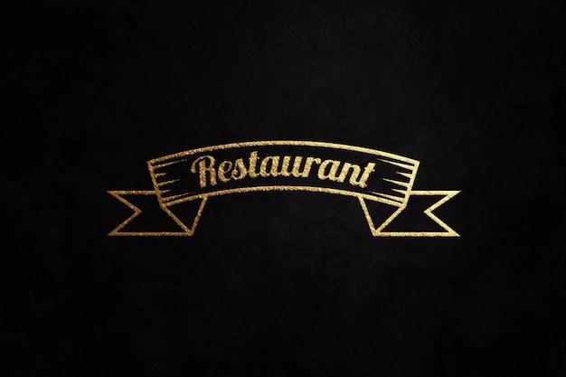 Maquete do logotipo dourado de luxo em papel preto