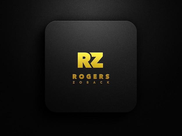 Maquete do logotipo dourado em fundo preto