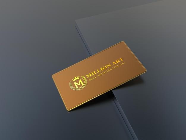 Maquete do logotipo dourado em maquete de cartão de visita de metal