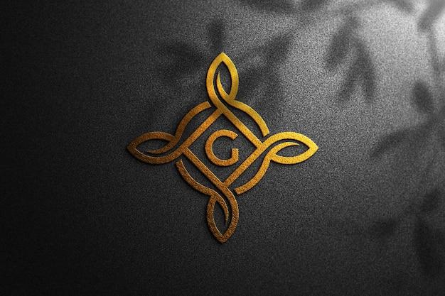Maquete do logotipo dourado em papel preto
