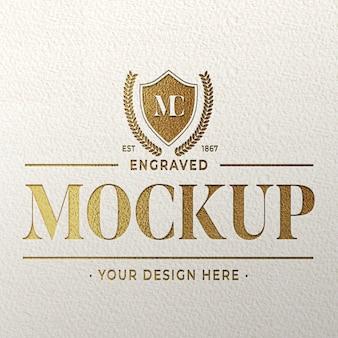 Maquete do logotipo dourado gravado