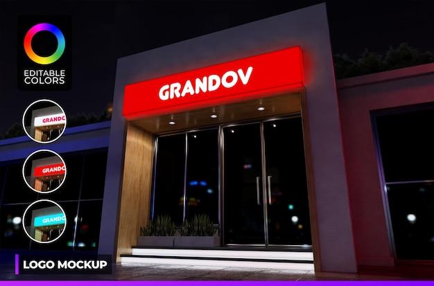 Maquete do logotipo em acrílico iluminado na frente da loja ou pequeno escritório com luz noturna