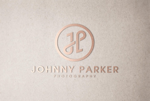 Maquete do logotipo em ouro rosa com relevo em papel artesanal