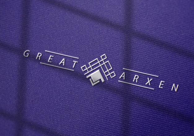 Maquete do logotipo em perspectiva na textura do tecido
