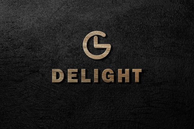 Maquete do logotipo esculpida em 3d de madeira na parede de concreto preto escuro