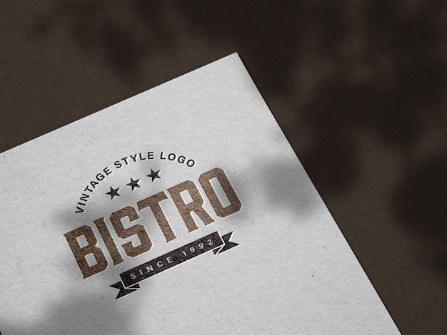 Maquete do logotipo gravada em papel não revestido