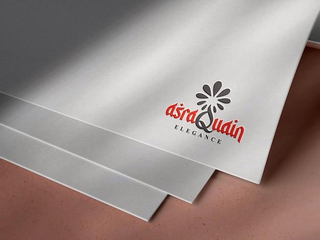 Maquete do logotipo gravado em papel branco