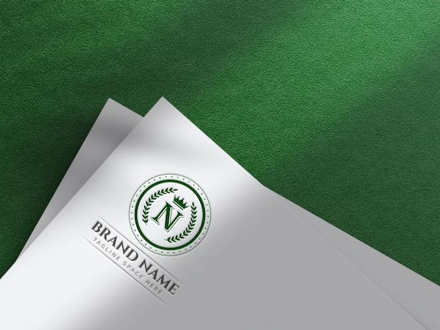 Maquete do logotipo gravado em papel recortado em branco