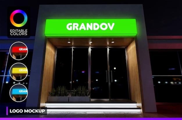 Maquete do logotipo iluminada na fachada da loja moderna ou na luz noturna do escritório