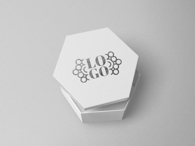Maquete do logotipo impresso em prata em formato de hexágono