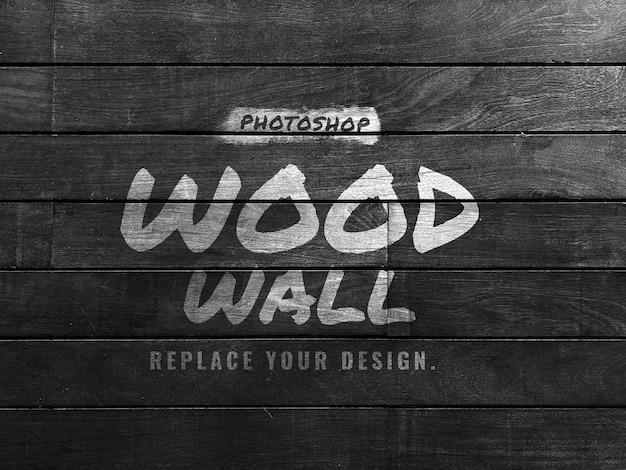 Maquete do logotipo na parede de madeira preta
