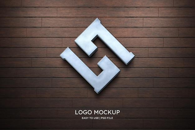 Maquete do logotipo na parede de madeira
