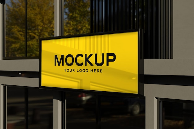 Maquete do logotipo na placa preta da loja