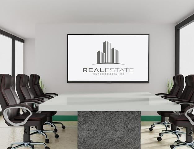 Maquete do logotipo na tv na sala de reuniões