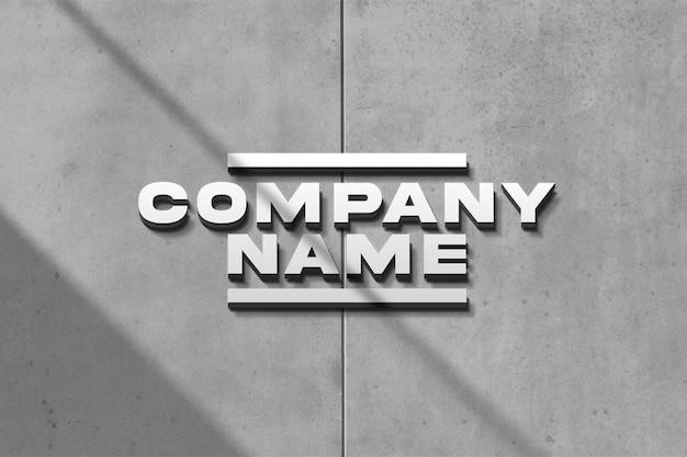 Maquete do logotipo prateado na parede de concreto