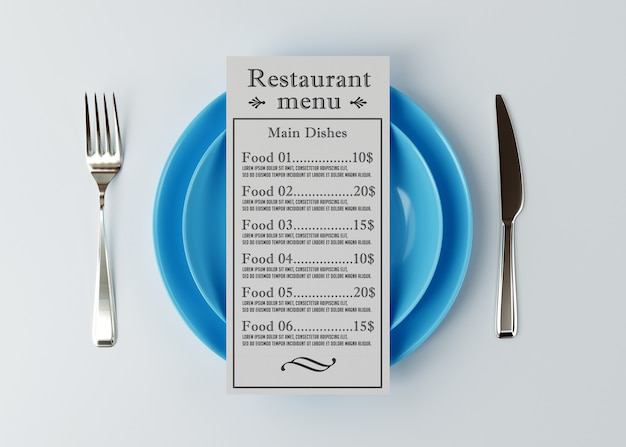 Maquete do menu fica acima de um prato com uma faca e garfo