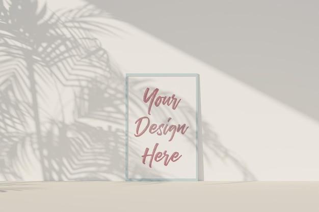 Maquete do porta-retrato com papel branco e sombra de folhas tropicais