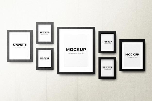 Maquete elegante e minimalista de molduras de fotos penduradas na parede