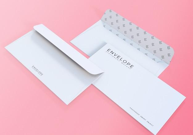 Maquete envelope escritório branco limpo fundo rosa