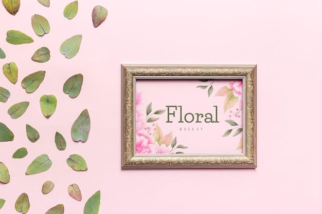 Maquete floral com folhas e moldura