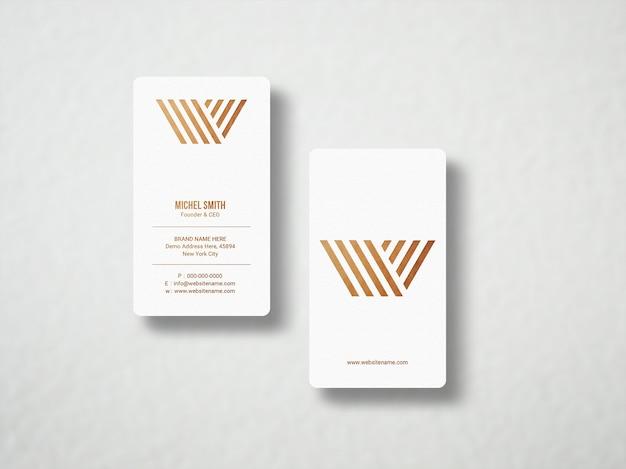 Maquete minimalista de cartão de visita em folha de ouro