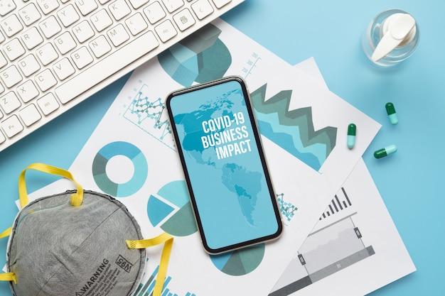 Maquete mobilephone para o conceito de impacto nos negócios covid-19.