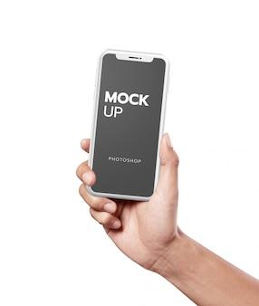 Maquete moderna de telefone branco na mão segurando
