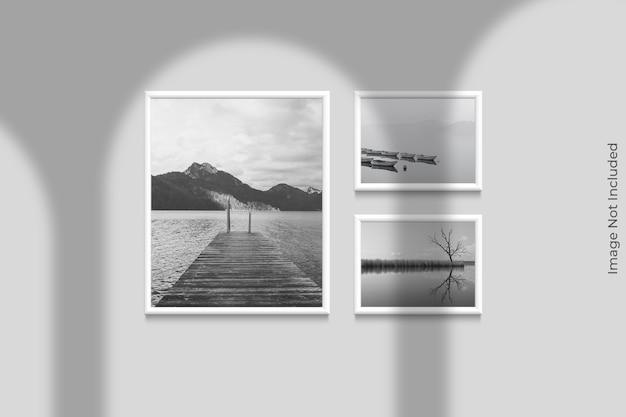 Maquete realista de quadros pendurada na parede com sobreposição de sombra