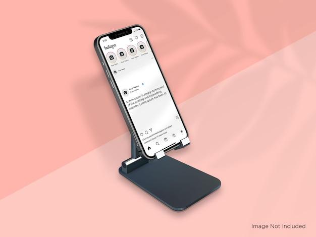 Maquete realista de smartphone no stand premium psd