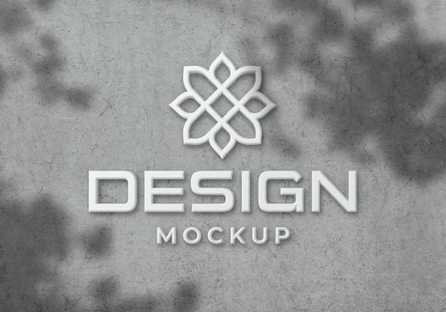 Maquete realista do logotipo na parede com sobreposição de sombra